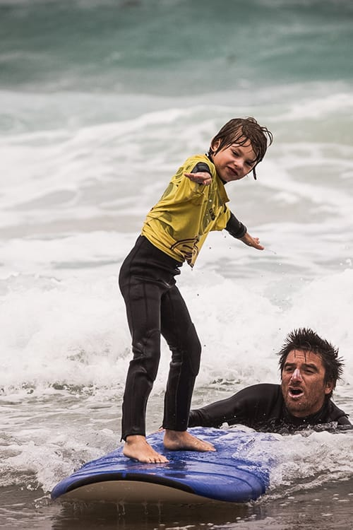 Kid learns to surf with the best surf teacher in Guincho, Portugal